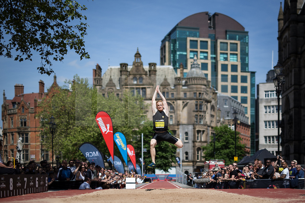 © Licensed to London News Pictures . 17/05/2014 . Manchester , UK . GREG RUTHERFORD . The Great City Games in Manchester , with athletics on a track along Deansgate and Pole Vault and Long Jump in Albert Square . Photo credit : Joel Goodman/LNP