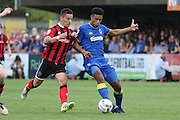 AFC Wimbledon striker Lyle Taylor (33) in action during the EFL Sky Bet League 1 match between AFC Wimbledon and Shrewsbury Town at the Cherry Red Records Stadium, Kingston, England on 24 September 2016. Photo by Stuart Butcher.
