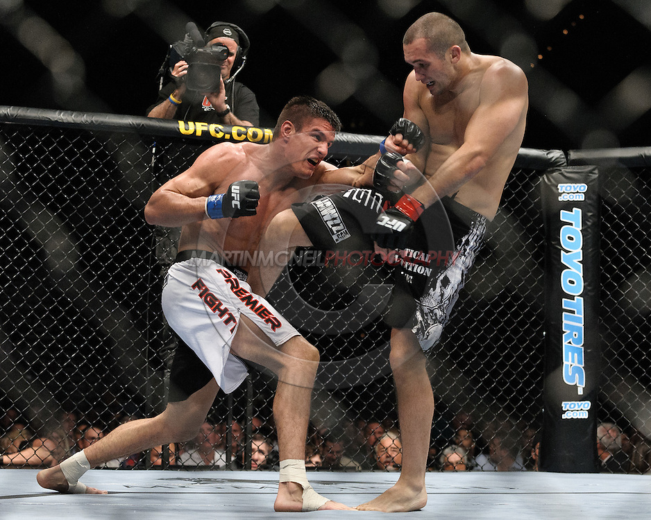 """LAS VEGAS, NEVADA, MAY 24, 2008: Goran Reljic (left) takes a kick to the thigh from Wilson Gouveia during """"UFC 84: Ill Will"""" inside the MGM Grand Garden Arena in Las Vegas"""