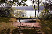 QUIET TIME -- A bench at the Redemptorist Retreat Center overlooks Crooked Lake. The retreat center offers visitors opportunities for quiet meditation in a natural setting. (Photo by Sam Lucero)