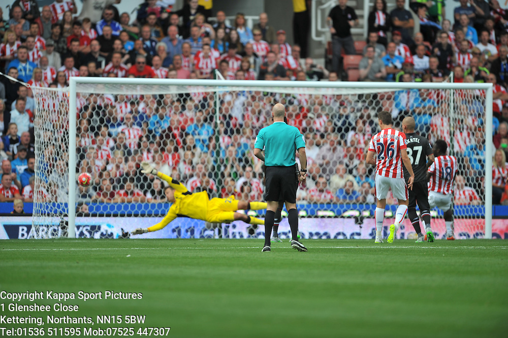LIVERPOOL KEEPER SIMON MIGNOLET MAKES A GREAT SAVE FROM STOKE MAME DIOUF SHOT ON TARGET, Stoke City v Liverpool, Premiership, Britannia Stadium Sunday 9th August 2015