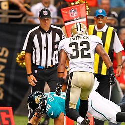 August 17, 2012; New Orleans, LA, USA; Jacksonville Jaguars tight end Colin Cloherty (46) dives past New Orleans Saints cornerback Johnny Patrick (32) for a touchdown during the first half of a preseason game at the Mercedes-Benz Superdome. Mandatory Credit: Derick E. Hingle-US PRESSWIRE