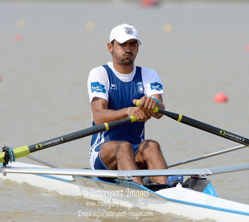 Chungju, South Korea.   IND M1X 	Sawarn SINGH (b) moves away from the start, Semi final A/B.  2013 Rowing Championships, Tangeum Lake, International Regatta Course.  Friday  30/08/2013 [Mandatory Credit. Peter Spurrier/Intersport Images]