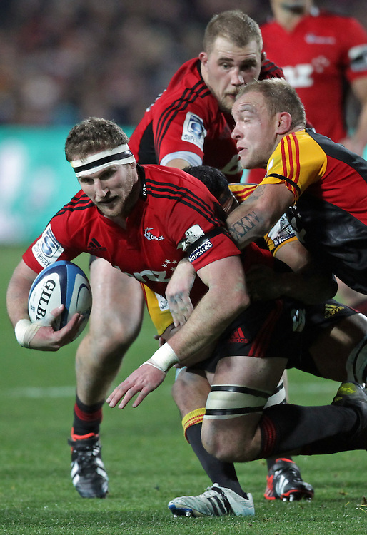 Crusaders' captain Kieran Read is tackled by Chiefs' Matt Vant Leven  in a Super Rugby semi final match, Waikato Stadium, Hamilton, New Zealand, Saturday, July 27, 2013.  Credit:SNPA / David Rowland