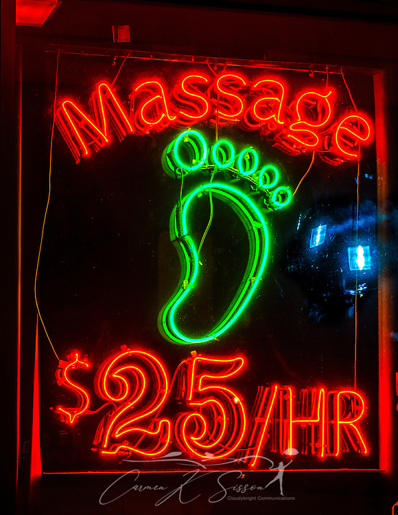 A neon sign advertises foot massages for $25 at Treat Your Feet in Doraville, Georgia, May 28, 2014. (Photo by Carmen K.Sisson/Cloudybright)