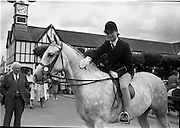 """08/08/1962<br /> 08/08/1962<br /> 08 August 1962 <br /> Dublin Horse show at the RDS, Ballsbridge, Dublin, Wednesday. Miss Wendy Marsh of Warrenpoint gives """"Paseel"""", a friendly pat on the head after winning Class 53 an open Childrens Pony Class. """"Paseel"""" a five year old grey, is owned by Mrs E.M. Gray, Clermont, Warrenpoint, Co. Down."""