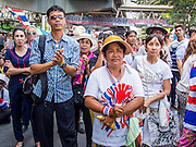 24 FEBRUARY 2014 - BANGKOK, THAILAND: Supporters of Suthep Thaugsuban during a rally the day after several violent attacks on protestors' sites over the weekend. At least four people, three of them children, were killed in political violence over the weekend in Thailand. One in Trat province, near the Cambodian border, and three in Bangkok, at the Ratchaprasong protest site. At the Ratchaprasong site a grenade was fired into a crowd killing a child and an adult. A second child, injured in the blast, died overnight in a Bangkok hospital.   PHOTO BY JACK KURTZ