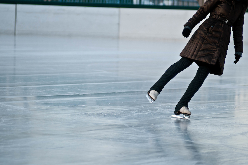 An ice skater enjoys a solitary early morning skate at the Frog Pond on the Boston Common.