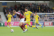 AFC Wimbledon midfielder Chris Whelpdale (11) and Northampton Town midfielder Matthew Taylor (31) during the EFL Sky Bet League 1 match between Northampton Town and AFC Wimbledon at Sixfields Stadium, Northampton, England on 20 August 2016. Photo by Stuart Butcher.