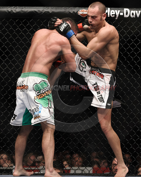 "LONDON, ENGLAND, JUNE 7, 2008: Marcus Davis (left) is pulled into a knee strike by Mike Swick during ""UFC 85: Bedlam"" inside the O2 Arena in Greenwich, London on June 7, 2008."