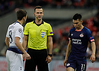 Football - 2017 / 2018 UEFA Champions League - Group B: Tottenham Hotspur vs. PSV Eindhoven<br /> <br /> Referee Ivan Kruzliak (SVK) stands firm as Harry Winks (Tottenham FC)  questions him over the free kick he had given at Wembley Stadium.<br /> <br /> COLORSPORT/DANIEL BEARHAM