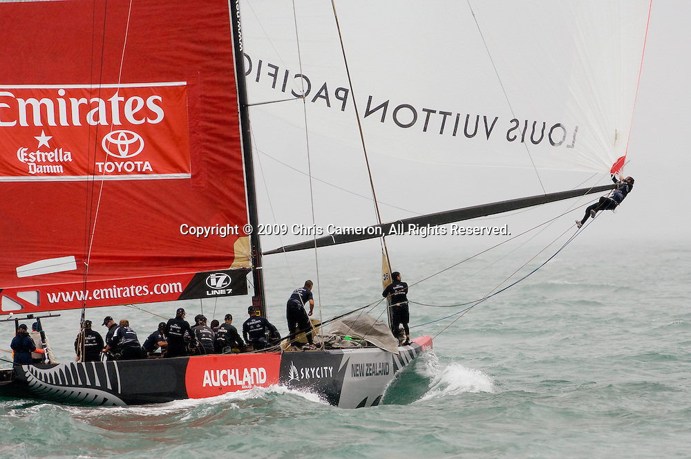 Emirates Team New Zealand prepare for a gybe on NZL84 in their Round Robin two match against BMW Oracle sailing NZL92. Louis Vuitton Pacific Series. 9/2/2009
