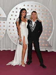 IGGY POP and his wife NINA ALU at the GQ Men Of The Year 2014 Awards in association with Hugo Boss held at The Royal Opera House, London on 2nd September 2014.