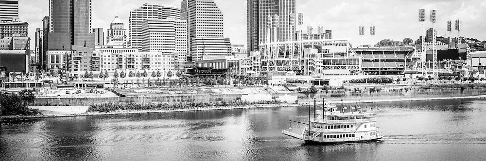 Cincinnati panoramic picture in black and white with downtown Cincinnati city office building, Great American Ballpark, Great American Insurance Group Tower, Omnicare building, US Bank building, and Scripps Center building. Panoramic photo ratio is 1:3.