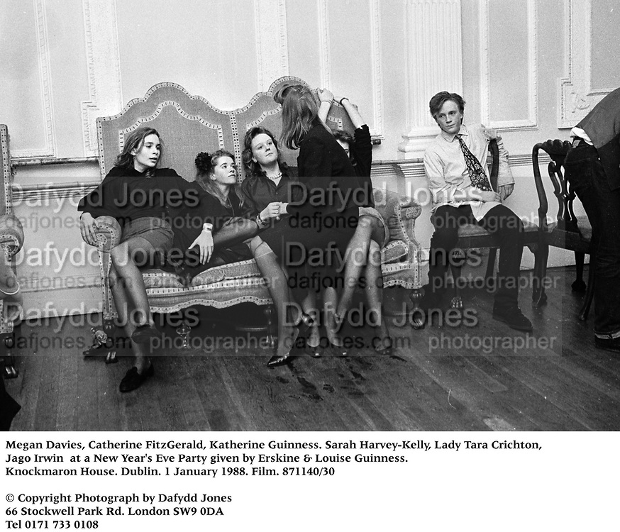 Megan Davies, Catherine FitzGerald, katherine Guinness. Sarah Harvey-Kelly, Lady Tara Crichton, Jago Irwin at a New Year's Eve Party given by Erskine &amp; Louise Guinness. Knockmaron House. Dublin. 1 January 1988. Film. 871140/30<br />