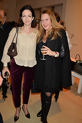 Left to right, CELIA WEINSTOCK and GEORGINA STEWART at Fashions for The Future presented by Oceana's Junior Council held at Phillips Auction House, 30 Berkeley Square, London on 19th March 2015.