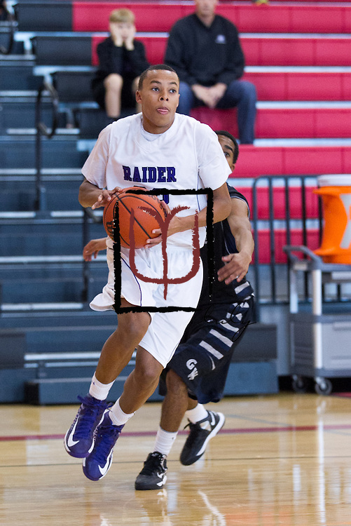 Cedar Ridge's Brice Dudley prepares to shoot against Shoemaker during the Leander ISD Tournament Friday.  The Raiders beat the Grey Wolves 58-37 at Vista Ridge Gym.