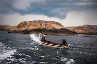 Fishermen braving storm clouds and choppy waters of the bay.