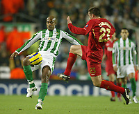 Photo: Aidan Ellis.<br /> Liverpool v Real Betis. UEFA Champions League.<br /> 23/11/2005.<br /> Liverpool's Jamie Carragher challenges Betis Marcos Assuncao