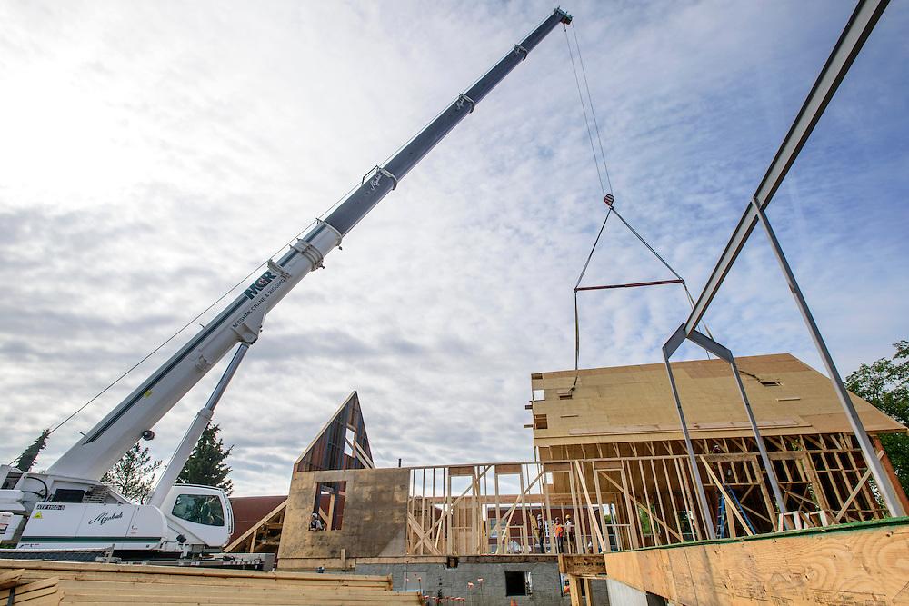 Canada, Edmonton. Aug/10/2013. McKernan Community League building renovation project. Roof framing and ibeam construction.
