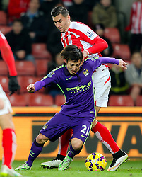 Stoke City's Philipp Wollscheid brings down Manchester City's David Silva for a penalty - Photo mandatory by-line: Matt McNulty/JMP - Mobile: 07966 386802 - 11/02/2015 - SPORT - Football - Stoke - Britannia Stadium - Stoke City v Manchester City - Barclays Premier League