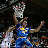 UCLA's Lonzo Ball (2) is fouled by Oregon State's JaQuori McLaughlin, left, during the second half of an NCAA college basketball game in Corvallis, Ore., Friday, Dec. 30, 2016. UCLA won 76-63. (AP Photo/Timothy J. Gonzalez)