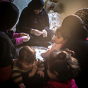 Syrian women, refugees in Irbid, cook for their family in a room of their appartment, on december 22nd 2013.
