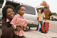 Family Unpacking Minivan