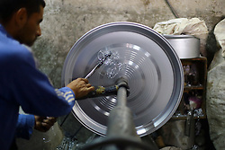 An Egyptian worker makes aluminous cooking pots at a local factory in Mit Ghamr of Dakahlia, 150 km north of Cairo, Egypt, on March 13, 2016. There are about 1,500 aluminous product factories in Mit Ghamr with over 80,000 workers employed. These factories produce over 80% of Egypt's domestic aluminous products and many of the products are exported to other African countries. EXPA Pictures © 2016, PhotoCredit: EXPA/ Photoshot/ Ahmed Gomaa<br /> <br /> *****ATTENTION - for AUT, SLO, CRO, SRB, BIH, MAZ, SUI only*****