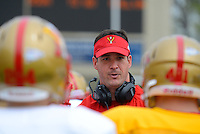 VMI defensive coordinator Greg Harris talks to his squad at the end of Saturday's scrimmage at Foster Stadium.
