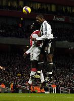 Photo: Olly Greenwood.<br />Arsenal v Newcastle United. The Barclays Premiership. 18/11/2006. Newcastle's Titus Bramble heads above Arsenal's Kolo Toure