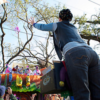 Krewe of Thoth parade on the Sunday before Mardi Gras, parading in Uptown along St. Charles Avenue, New Orleans, Louisiana, USA. Thoth is known for parading on a route designed to pass institutions that care for persons with disabilities and illnesses.  Founded in 1947, the Krew of Thoth is named for the Egyptian god of wisdom.