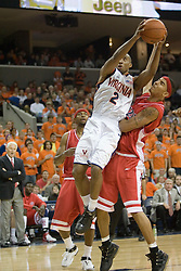 Virginia's J.R. Reynolds draws contact from an Arizona defender.  UVA defeated the #10 ranked Wildcats 93-90 in the first game at the new John Paul Jones Arena, in Charlottesville, VA on November 12, 2006...