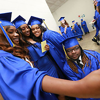 Emerald McCoy, from left, Lakin Morris, Marie Mitchell and Deavontae Betts grab a selfie before heading out for the Tupelo High School graduation Friday night.