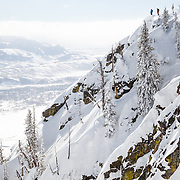 Drew Petersen and Tigger Knecht stand on an inbounds zone at Jackson Hole Mountain Resort.