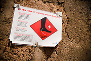 Information sign on guinea worm outside the guinea worm case containment center in Savelugu, northern Ghana, on Friday March 9, 2007. A parasite transmitted through water, guinea worm emerges from the host's body nine months after drinking contaminated water. Measuring up to 1 meter, it can only be pulled out a few cm every day to prevent it from breaking inside the host's body. Despite a widespread eradication program Ghana has the second largest number of cases in the world - after Sudan..