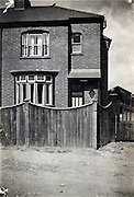 house with wooden fence England 1900s