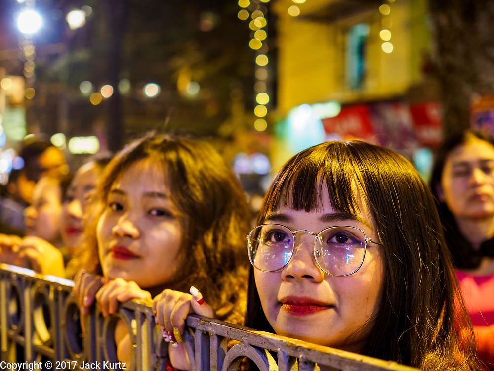 22 DECEMBER 2017 - HANOI, VIETNAM: People watch the Christmas show at St. Joseph's Cathedral in Hanoi. There are about 5.6 million Catholics in Vietnam. The Cathedral was one of the first structures built by the French during the colonial era and was opened in 1886. It's one of the most popular tourist attractions in Hanoi.    PHOTO BY JACK KURTZ