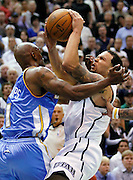 Denver Nuggets guard Chauncey Billups (1) fouls Utah Jazz guard Deron Williams during the second half of Game 4 of the NBA Western Conference first-round playoff series in Salt Lake City, Sunday, April 25, 2010. (AP Photo/Colin E Braley)