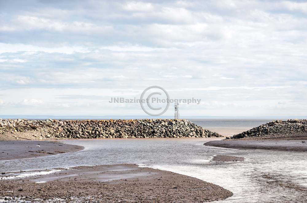 An inlet in St. Martins New Brunswick is drained of water during low tide