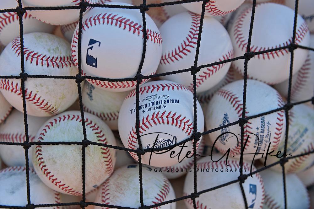 Batting practice baseballs prior to a game between the Kansas City Royals and the Baltimore Orioles at Kauffman Stadium.