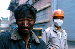 CHINA SHANGHAI NOV01 - A dirty shipyard worker smiles after the end of his shift.. . jre/Photo by Jiri Rezac. . © Jiri Rezac 2001. . Contact: +44 (0) 7050 110 417. Mobile:  +44 (0) 7801 337 683. Office:  +44 (0) 20 8968 9635. . Email:   jiri@jirirezac.com. Web:     www.jirirezac.com