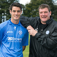 Striker Brian Graham pictured with manager Tommy Wright this morning after completing his season long loan deal from Dundee United to St Johnstone...28.08.14<br /> Picture by Graeme Hart.<br /> Copyright Perthshire Picture Agency<br /> Tel: 01738 623350  Mobile: 07990 594431