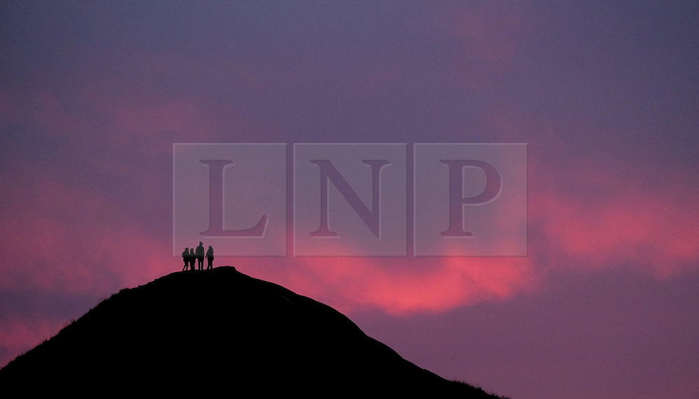 © Licensed to London News Pictures. <br /> 21/12/2016. <br /> Saltburn-by-the-Sea, UK.  <br /> <br /> A group of friends stand on the top of a hill called Catnab to watch the sun begin to rise on the morning of the Winter Solstice, the shortest day of the year in Saltburn-by-the-Sea.<br /> <br /> <br /> <br /> Photo credit: Ian Forsyth/LNP