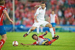 OSLO, NORWAY - Wednesday, August 5, 2009: Liverpool's Javier Mascherano in action against FC Lyn Oslo's Edwin Kjeldner during a preseason match at the Bislett Stadion. (Pic by David Rawcliffe/Propaganda)