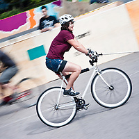 London, UK - 24 August 2012: a player rides her bike at the Hell's Belles Vol 2, Ladies Bike Polo Tournament in Bethnal Green Gardens.