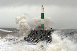 © Licensed to London News Pictures. 23/12/2013. Aberystwyth, UK Aberystwyth light house. Stormy seas at Aberystwyth this morning, 23rd December 2013. There are 127 flood alerts in place across the UK as stormy weather reaches the country. Photo credit : Jon Freeman/LNP
