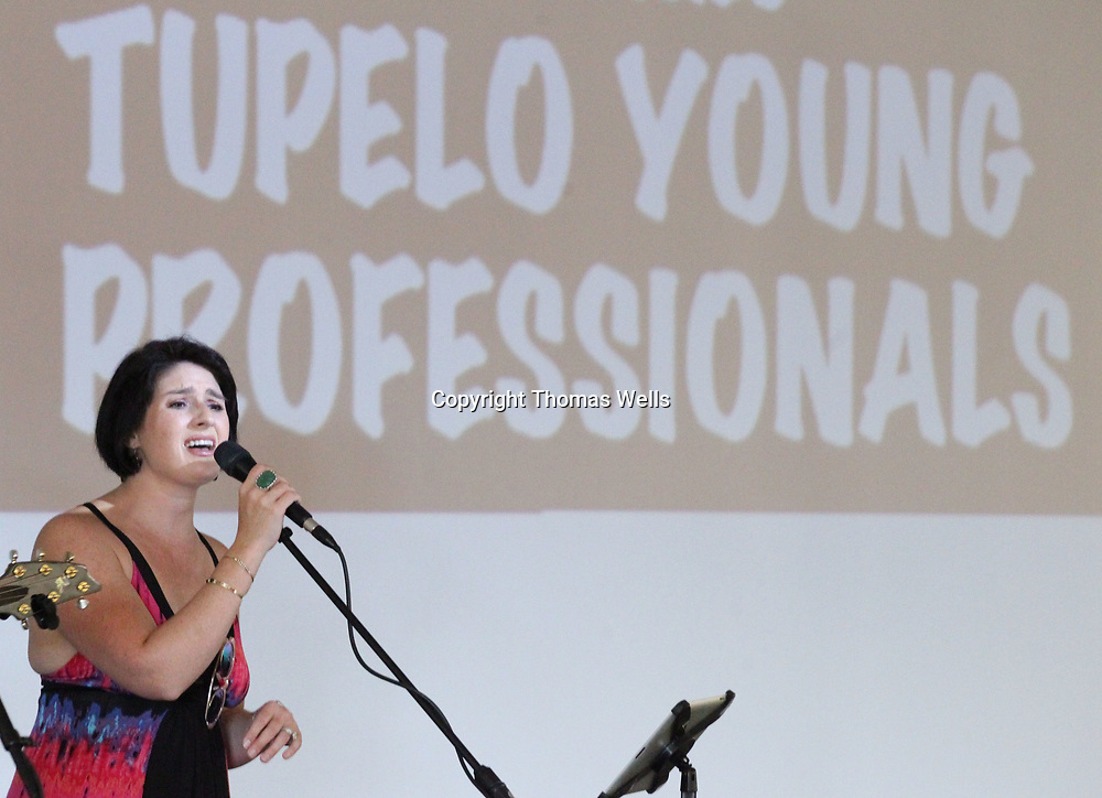 Mary Frances Massey performs Thursday night at Mitchell Distributing in Shannon for the Tupelo Young Professionals gathering put on by the Community Development Foundation.