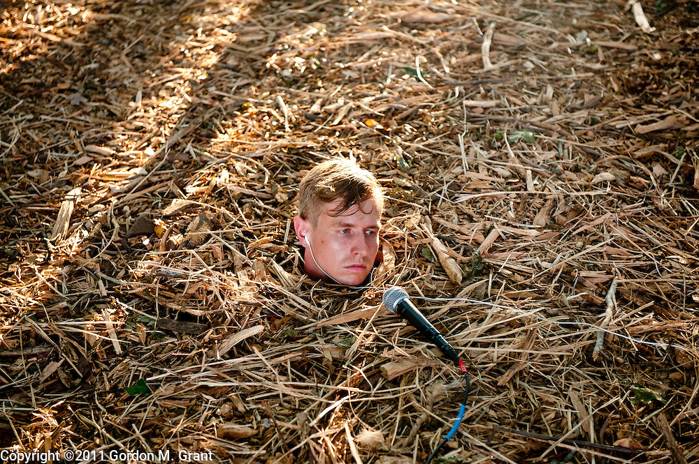 Water Mill, NY - 7/30/11 - A performers head buried in the ground in art installation at the Watermill Center benefit in Water Mill, NY July 30, 2011. CREDIT: Gordon M. Grant for The Wall Street Journal.NYSCENE_watermill center