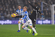 Alex Pritchard of Huddersfield Town (21) and Jean Michaël Seri of Fulham (24) come together during the Premier League match between Huddersfield Town and Fulham at the John Smiths Stadium, Huddersfield, England on 5 November 2018.